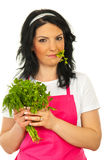Beauty woman holding parsley Stock Image