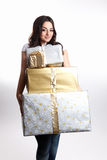 Beauty woman holding presents Stock Images