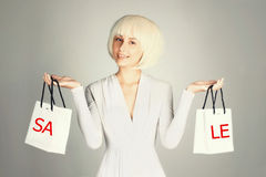 Beauty woman holding shopping bags Stock Photography