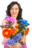 Beauty woman holding spring flowers Royalty Free Stock Photography