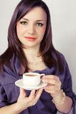 Beauty woman holds cup Royalty Free Stock Photography
