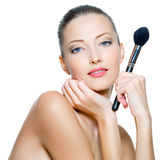 Beauty woman  holds make-up brushes Royalty Free Stock Image
