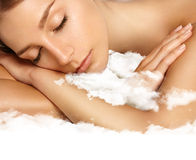 Beauty woman with ideal skin sleaping on a cloud Stock Images