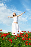 Beauty Woman In Poppy Field Royalty Free Stock Images