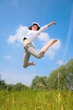Beauty woman jumps on grass Stock Photography