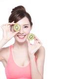 Beauty woman and Kiwi fruit Stock Images