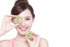 Beauty woman and Kiwi fruit Royalty Free Stock Image