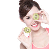 Beauty woman and Kiwi fruit Stock Photo