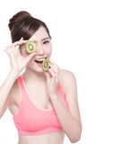 Beauty woman and Kiwi fruit Stock Photos