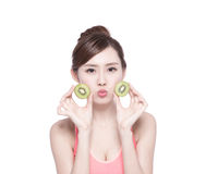 Beauty woman and Kiwi fruit Royalty Free Stock Photo