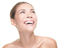 Beauty woman laughing. / smiling looking at copy space. Face beauty portrait of happy young asian / caucasian model isolated on white background Royalty Free Stock Photo