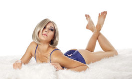 Beauty woman lay on fur in lingerie Royalty Free Stock Photo
