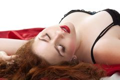 Beauty woman lay on red in lingerie Royalty Free Stock Image