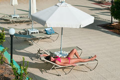 Beauty woman laying on beach bed Stock Photo