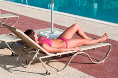 Beauty woman laying near pool Royalty Free Stock Photography