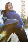 Beauty woman leaned against car Royalty Free Stock Photos