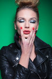 Beauty woman in leather jacket with eyes closed Stock Images