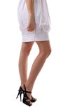 Beauty woman legs in white cloth Stock Photography