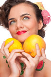 Beauty woman with lemon and grapefruit Stock Image