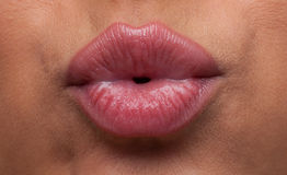 Beauty woman lips blow close-up Stock Photography
