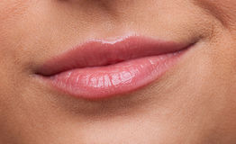 Beauty woman lips smile contempt close-up Stock Photos
