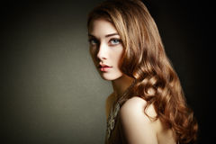 Beauty woman with long curly hair. Beautiful girl with elegant h Royalty Free Stock Photography