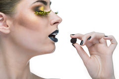 Beauty woman with long  lashes and black lips Stock Photos