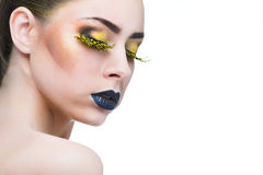 Beauty woman with long yellow lashes and black lips. Over white background Royalty Free Stock Images