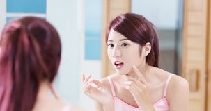 Beauty woman look mirror. In the bathroom royalty free stock images