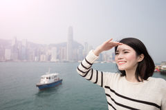 Beauty woman look somewhere. Beauty woman smile and look somewhere in hongkong Stock Image
