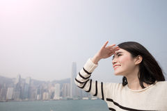 Beauty woman look somewhere. Beauty woman smile and look somewhere in hongkong Stock Images