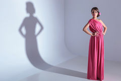 Beauty woman looks down with hands on hips Stock Image