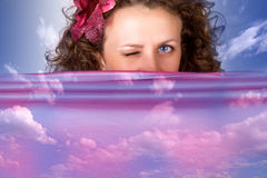 Beauty. Woman and lower on blue background Royalty Free Stock Photography