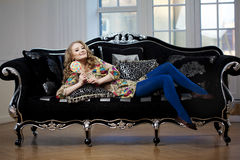 Beauty woman in luxurious sofa Stock Photography