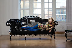Beauty woman in luxurious sofa Royalty Free Stock Photos