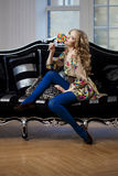 Beauty woman in luxurious sofa Royalty Free Stock Image
