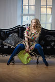 Beauty woman in luxurious sofa with handbag Royalty Free Stock Images