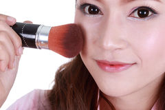 Beauty woman with Makeup Brush Stock Photography