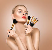 Beauty woman with makeup brushes Stock Photo