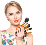 Beauty woman with makeup brushes Royalty Free Stock Image