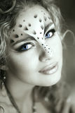 Beauty woman with makeup in snow leopard style. Fashion makeup m Royalty Free Stock Photography