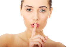 Beauty woman making hush gesture. Royalty Free Stock Photos