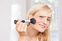 Beauty woman making-up Stock Photography
