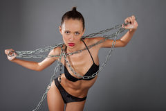 Beauty woman with metall chain Stock Image