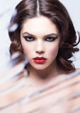 Beauty woman model with makeup through mirror stock photo