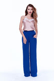Beauty woman model wear stylish design trend clothing silk blue. Pants casual formal office style for work meeting walk party long blond hair makeup party Royalty Free Stock Photos