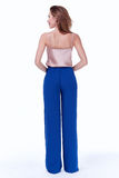 Beauty woman model wear stylish design trend clothing silk blue. Pants casual formal office style for work meeting walk party long blond hair makeup party Stock Photos