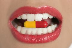 Beauty woman mouth with medicine pill Royalty Free Stock Images