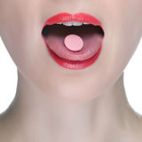 Beauty woman mouth with red lips and medicine pill Stock Photos