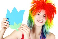 Beauty woman in multicolored wig with paper flower Royalty Free Stock Images